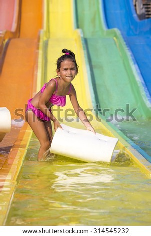 Girl on  the water slide - stock photo