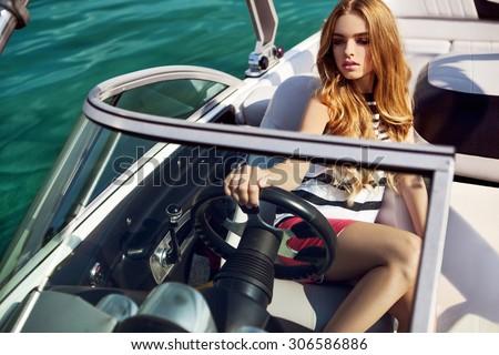 Girl on yacht in ocean - stock photo