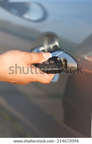 girl opens a car - stock photo