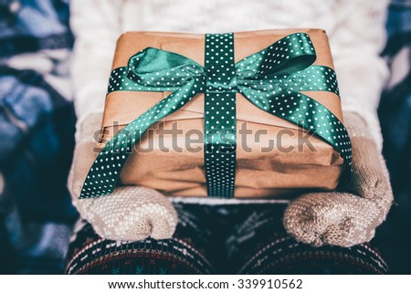 Girl opens a wonderful vintage gift - stock photo