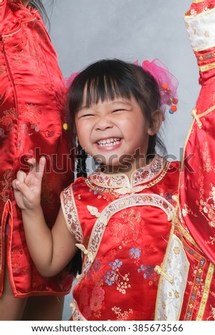 girl or chinese little girl with traditional chinese cheongsam dress