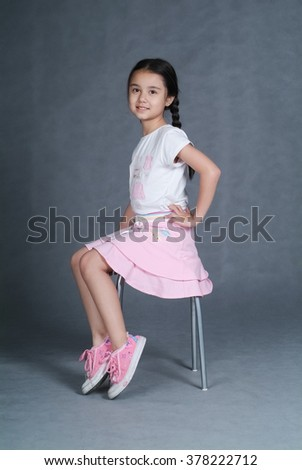 girl or little girl posing on chair