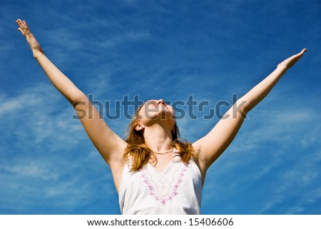Girl over blue sky. Happy summer concept. - stock photo