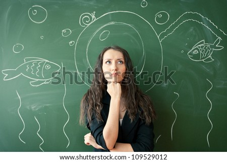 girl over chalkboard with funny painted  diver costume
