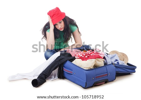 Girl packing for travel vacation - stock photo