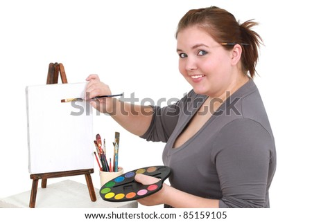 Girl painting on a canvas - stock photo