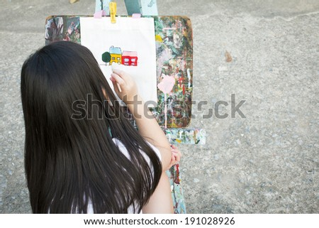 girl painting on the canvas - stock photo