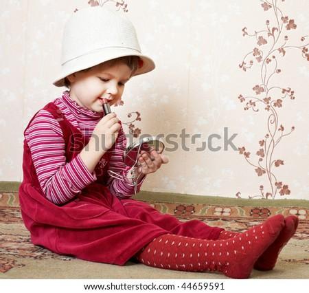 girl paints her lips lipstick - stock photo