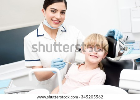 Girl patient going to get dental treatment - stock photo