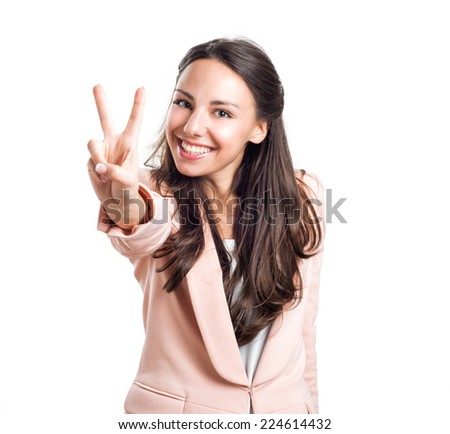 Girl peace gesturing with hand, isolated on white background - stock photo