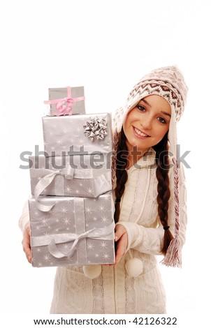 Girl peeking round stack of presents on white background - stock photo