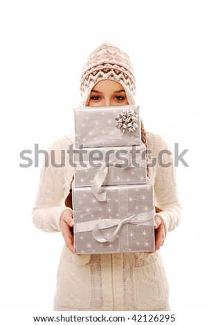 Girl peering over stack of gifts on white background - stock photo