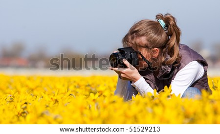 Girl photographer making pictures of flowers. Spring in the Netherlands