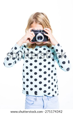 Girl photographing with an old film camera - stock photo