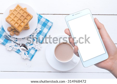 Girl photographs on a mobile phone food. Mobile technology. Mobile photo. Insert text - stock photo