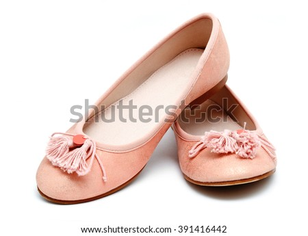 Girl pink shoes isolated on a white background