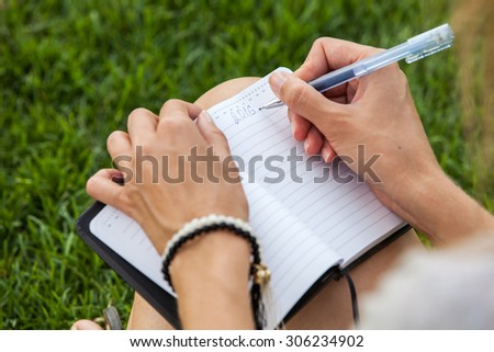 Girl planning new 2016 year outdoor - stock photo