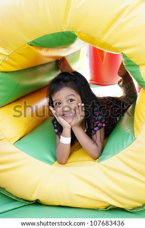 Girl playing at inflatable amusement park. - stock photo