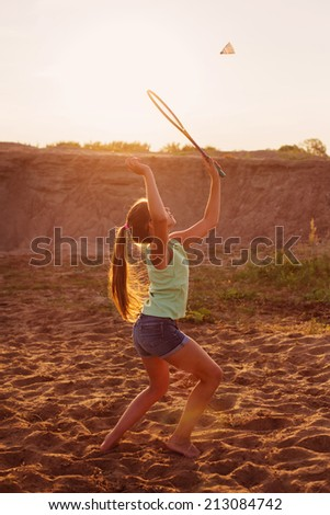 girl playing badminton outdoor - stock photo