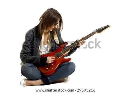 girl playing guitar seated