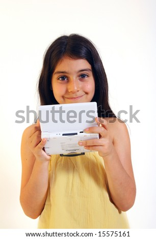 Girl playing hand-held video game - stock photo