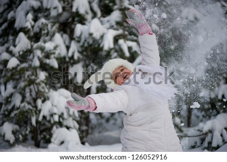 girl playing in a winter forest - stock photo