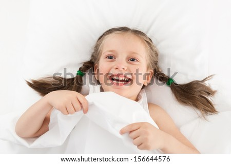 girl playing in bed - stock photo