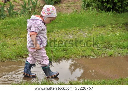 girl playing in the puddle