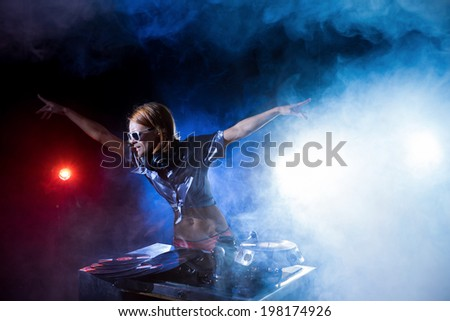 Girl playing on an unusual player - stock photo