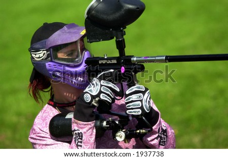 girl playing paintball during tournement