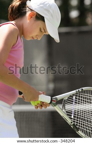 Girl playing tennis - concentration