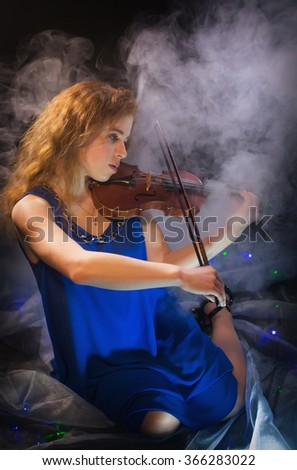 Girl playing the violin - stock photo