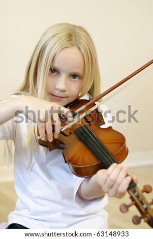 Girl playing violin - stock photo