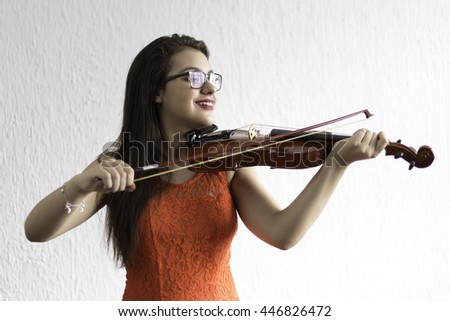 girl playing violin with white background