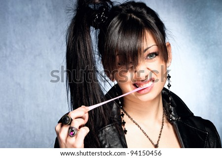 girl playing with chewing gum - stock photo