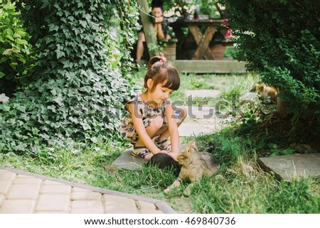 girl playing with kittens