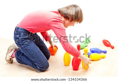 girl playing with skittles - stock photo