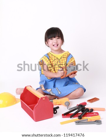 Girl playing with toys at happiness - stock photo