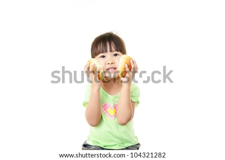 Girl pleased to get bread - stock photo