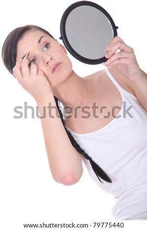 Girl plucking eyebrows - stock photo