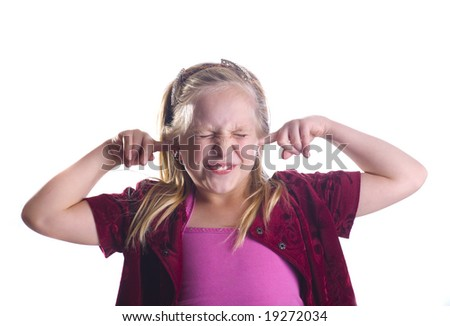 Girl plugging her ears and closing her eyes. - stock photo