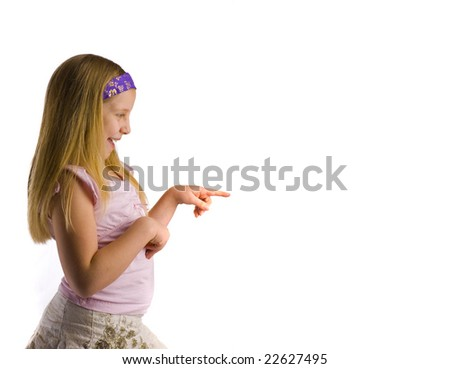 Girl pointing to white copy space - stock photo