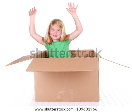 Girl popping out of cardboard box, on white