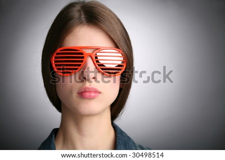 girl portrait in the  sunglasses with red strips - stock photo