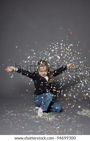 Girl portrait with confetti - stock photo