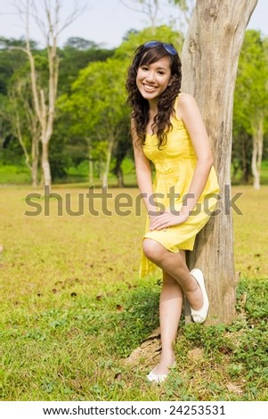 girl posing happily in the park