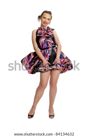 Girl posing in studio wind blows flying dress isolated on a white background
