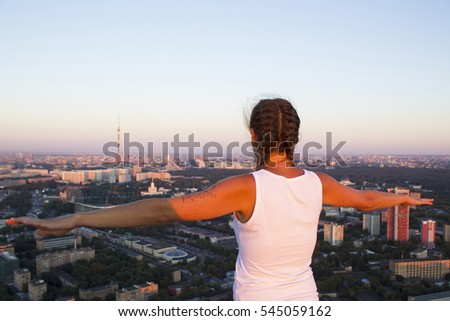 girl posing on the roof