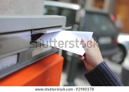 girl posting a letter - stock photo