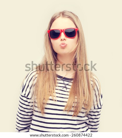 Girl pouting cheeks and blowing - stock photo